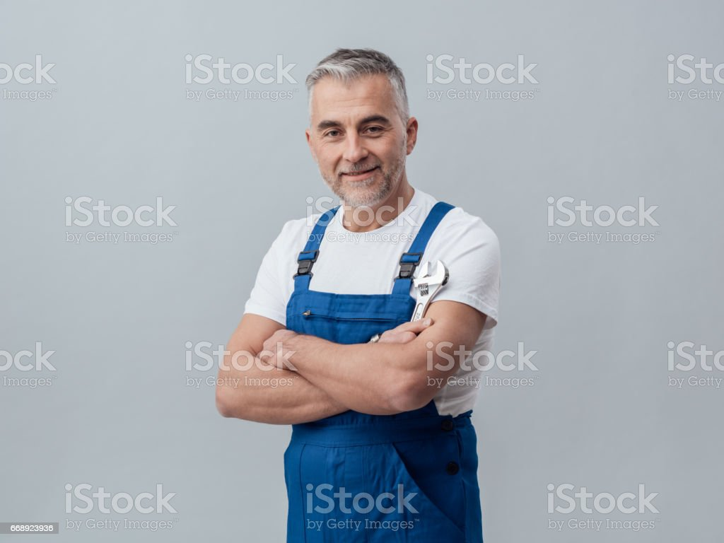 Plumber posing with a wrench stock photo