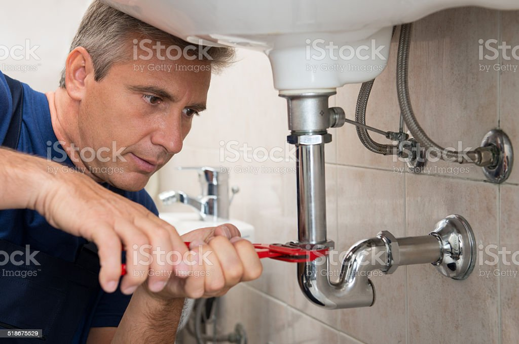 Plumber Repair Water Pipe stock photo