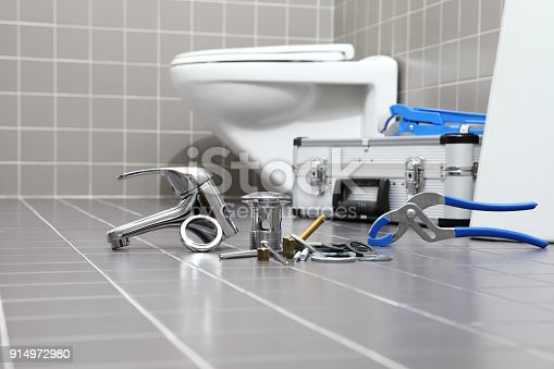 istock plumber tools and equipment in a bathroom, plumbing repair service, assemble and install concept 914972980