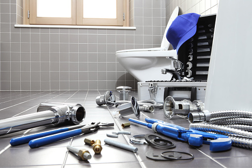istock plumber tools and equipment in a bathroom, plumbing repair service, assemble and install concept 948721450