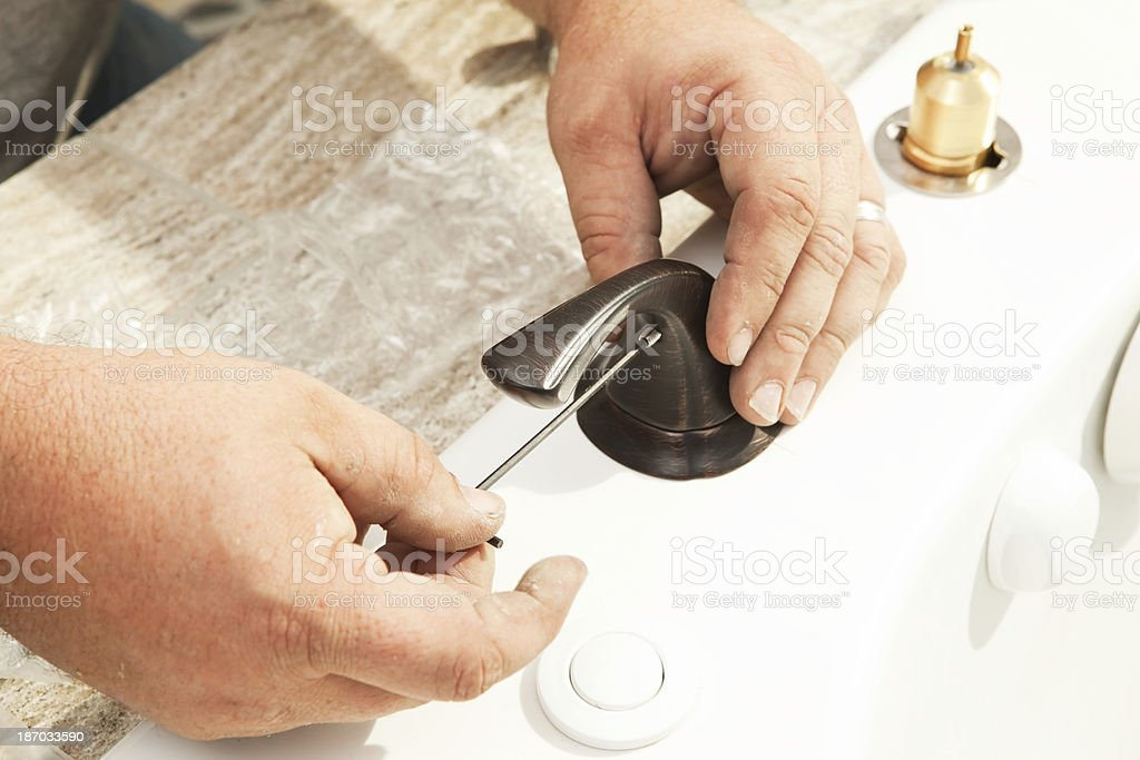 Plumber Using Hex Key Wrench To Install Bathtub Faucet Handle stock ...