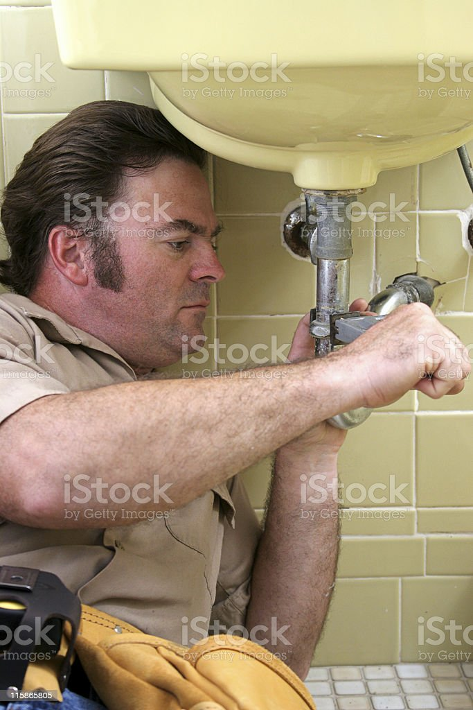 Plumber Using Pipe Wrench royalty-free stock photo