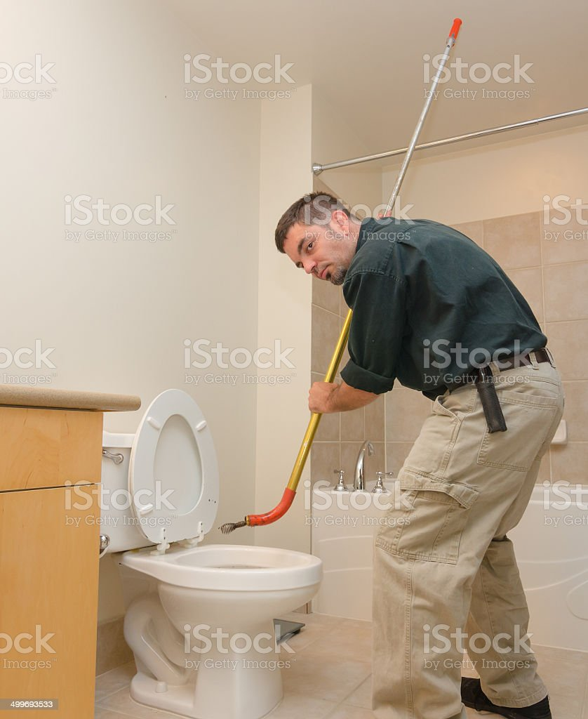 Plumber with auger stock photo