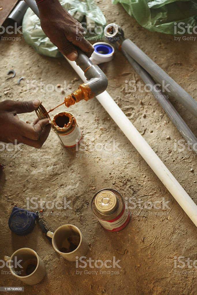 Plumber Working with C-PVC Pipes royalty-free stock photo