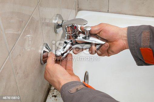 istock Plumber works in a bathroom 467615610