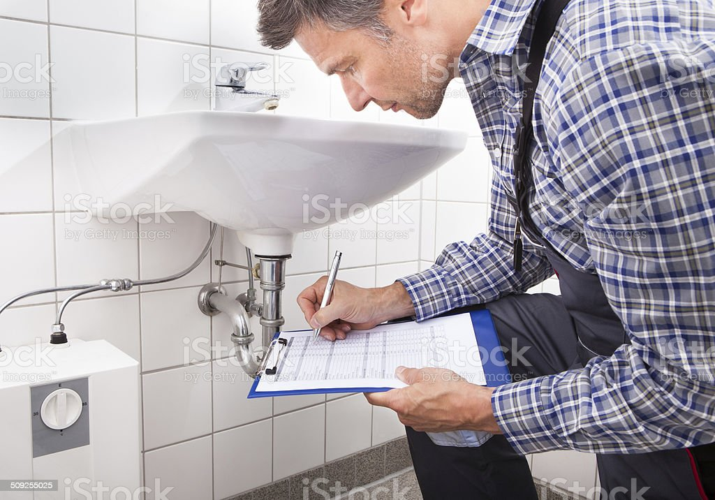 Plumber Writing On Clipboard royalty-free stock photo