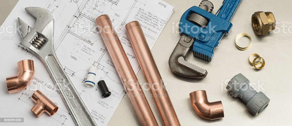 Plumbers Tools and Plumbing Materials Banner on House Plans stock photo
