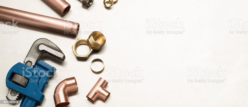 Plumbers Tools and Plumbing Materials Banner with Copy Space stock photo