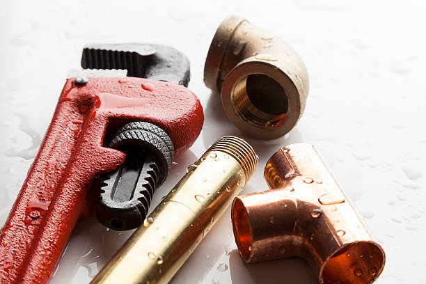 Plumber's Tools Group of plumber's tools. Ideal for website or promotional mailer. adjustable wrench stock pictures, royalty-free photos & images