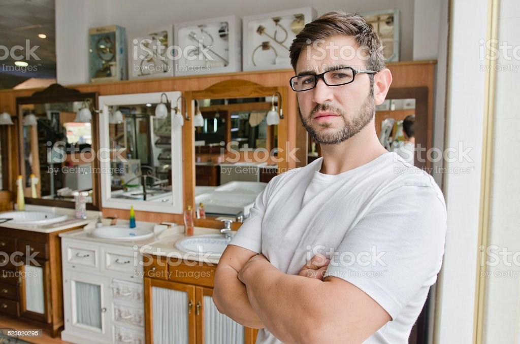 Plumbing and furniture store clerk or client posing stock photo