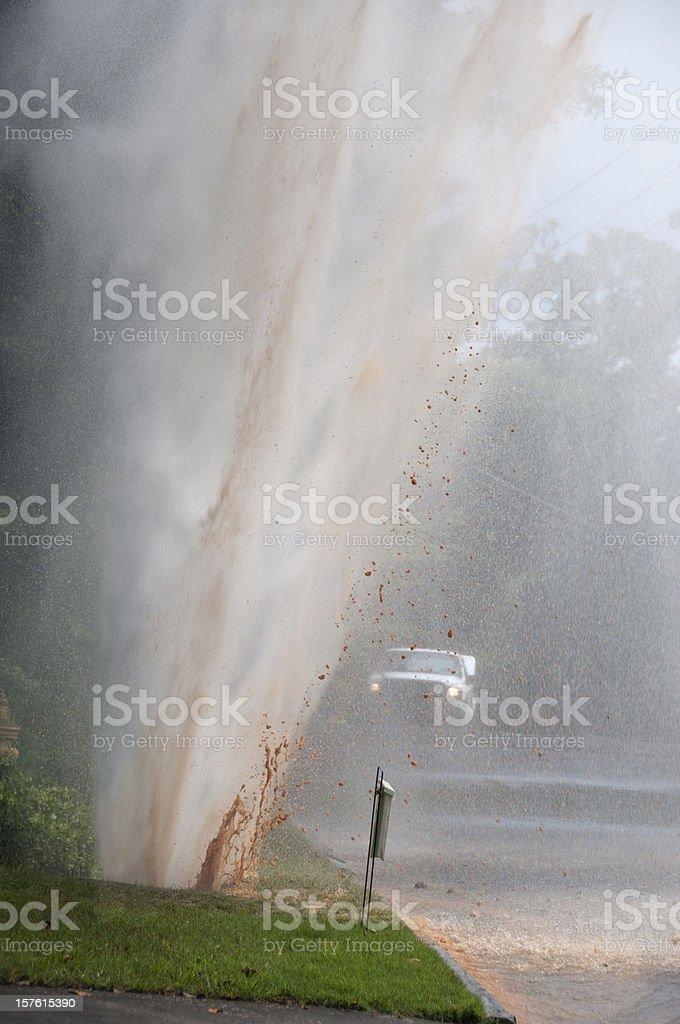 Plumbing Emergency: Water main pipe break stock photo