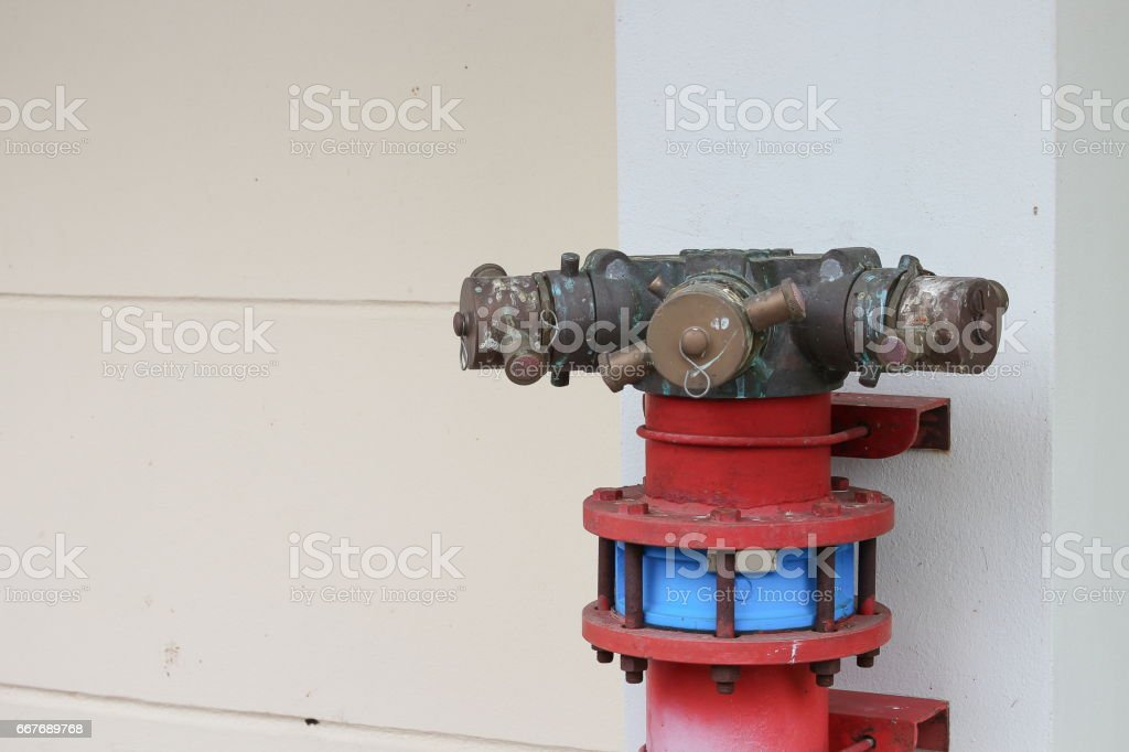 plumbing fire hydrant in a metal line wall, fireplug with valves
