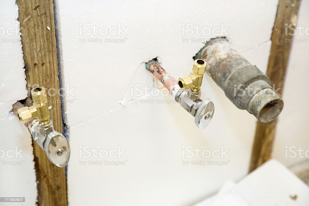 Plumbing Fixtures in Insulated Wall royalty-free stock photo