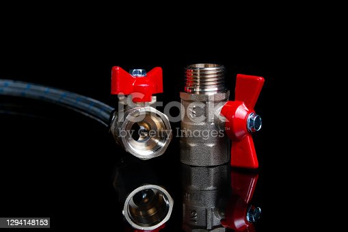 istock Plumbing gate ball vales and flexible water hose 1294148153