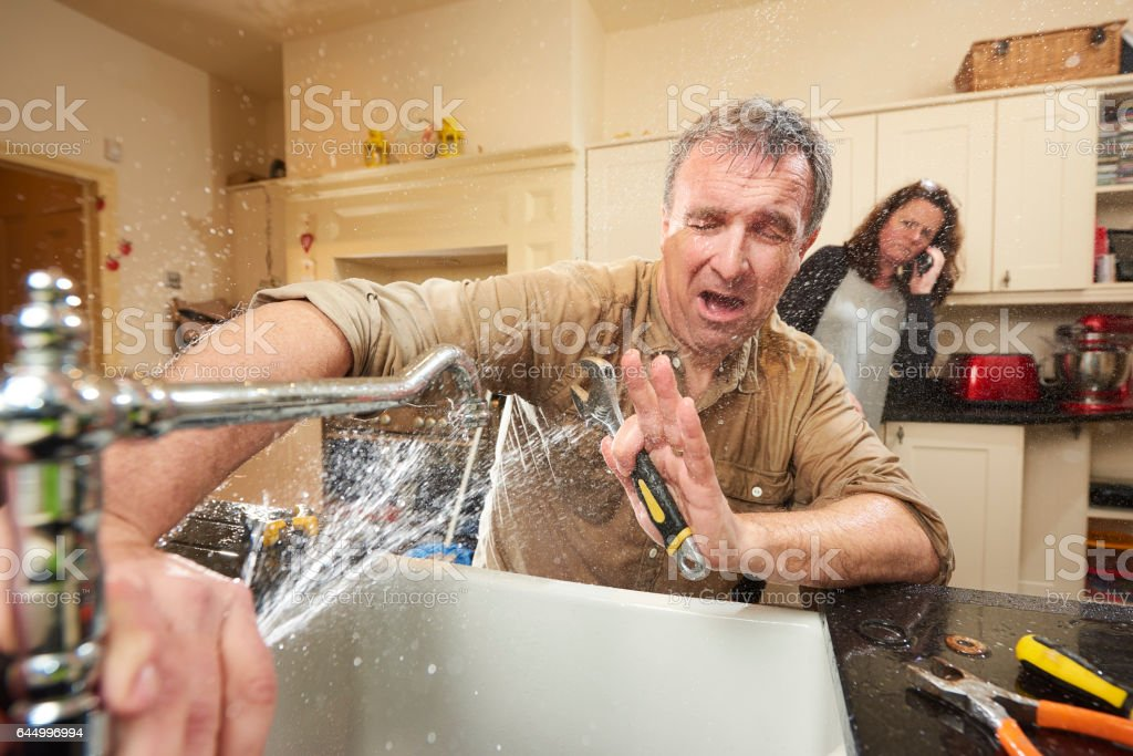 plumbing mishap stock photo