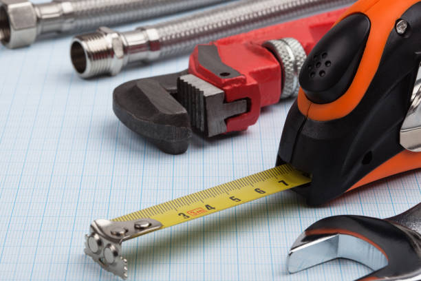 Plumbing supplies and tape measure. stock photo