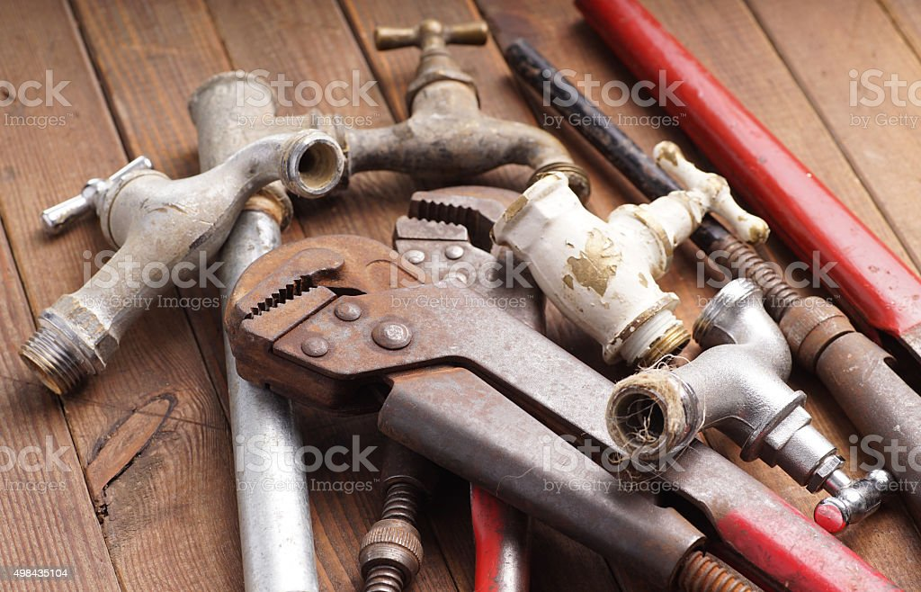 plumbing tools lying and vintage faucets stock photo