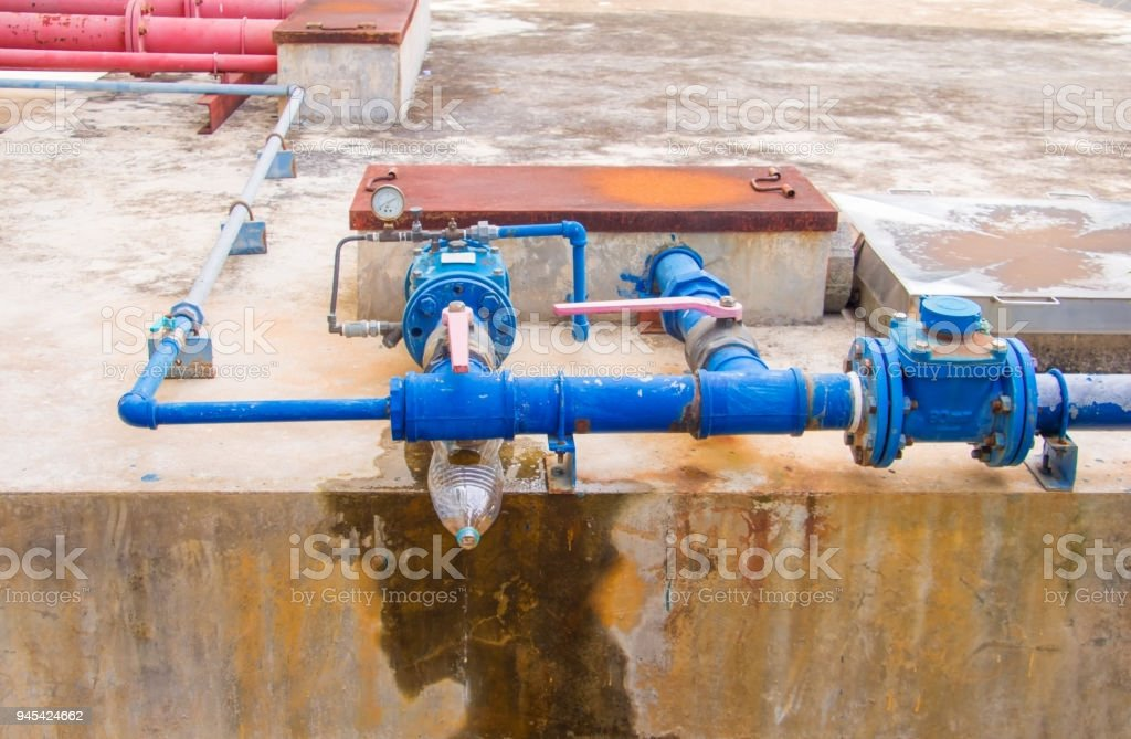 plumbing tube and water leak, steel rust old tap pipe with copy space...