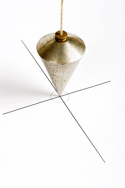 Plumbline Positioned On Centre Of Cross Graphic stock photo