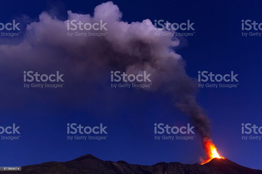 plume of ash and volcanic gases at dawn stock photo