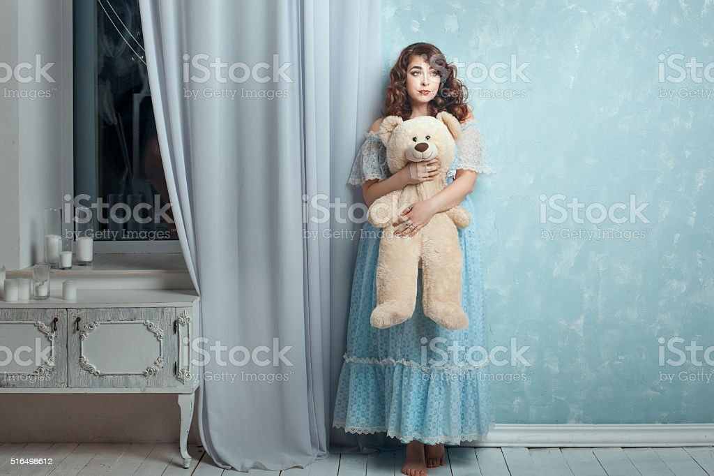 Plump woman with a bear in hands. stock photo