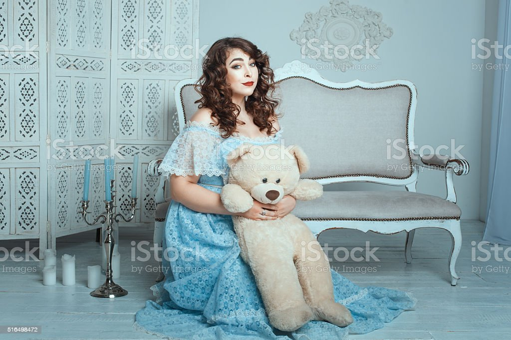 Plump woman with a toy bear. stock photo