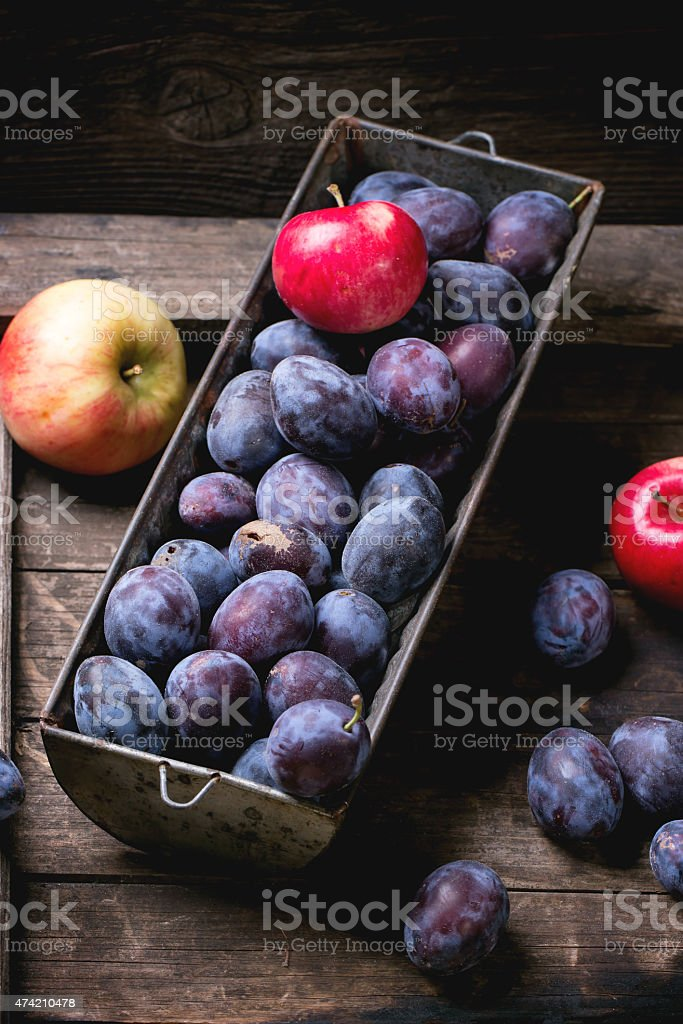 Plums and apples stock photo