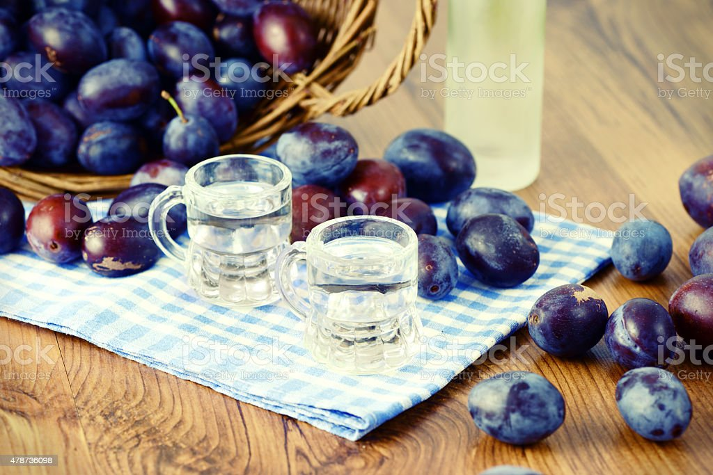 plums and liqueur glasses stock photo