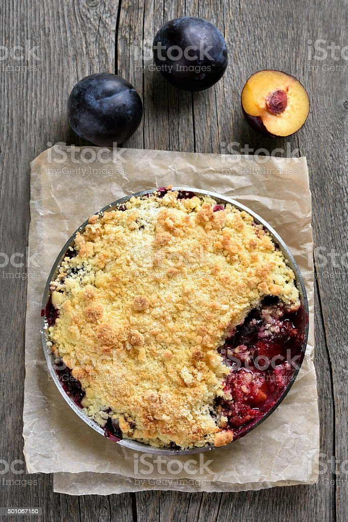 Plums crumble pie, top view stock photo