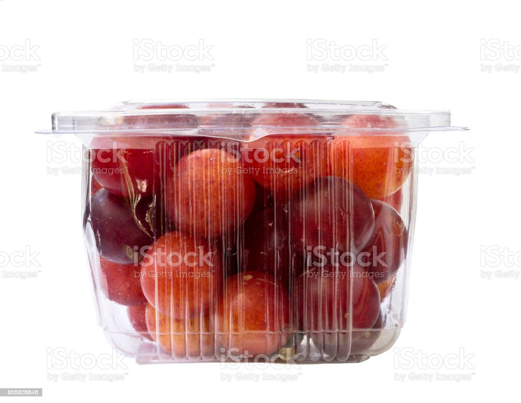 Plums fruit in plastic pack stock photo