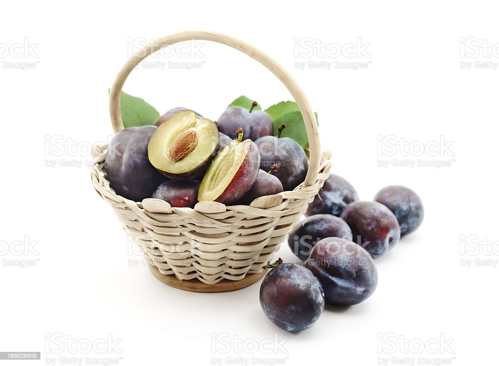 Plums in a basket stock photo