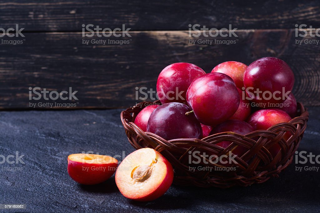 plums in basket stock photo
