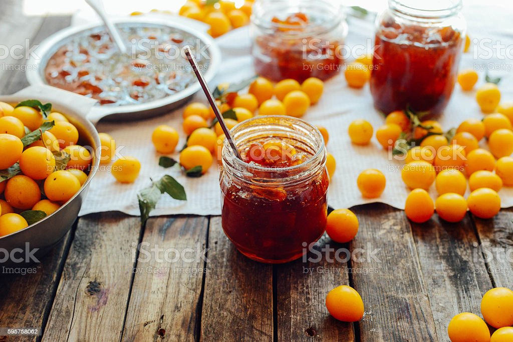 plums jam in a small cup. stock photo