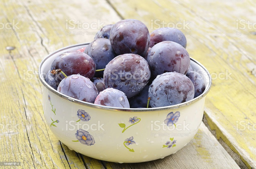 Plums on shabby wooden table royalty-free stock photo