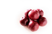istock Plums on white background 1132843606