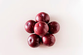 istock Plums on white background 1132844685