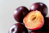 istock Plums on white background 1132844761