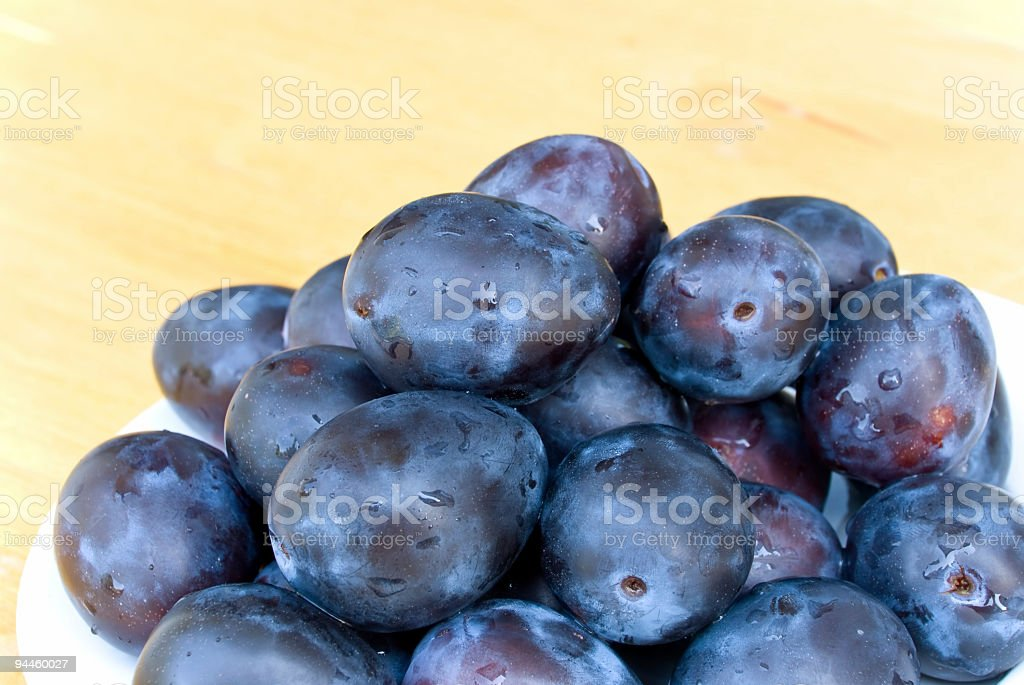 Plums on wooden background royalty-free stock photo