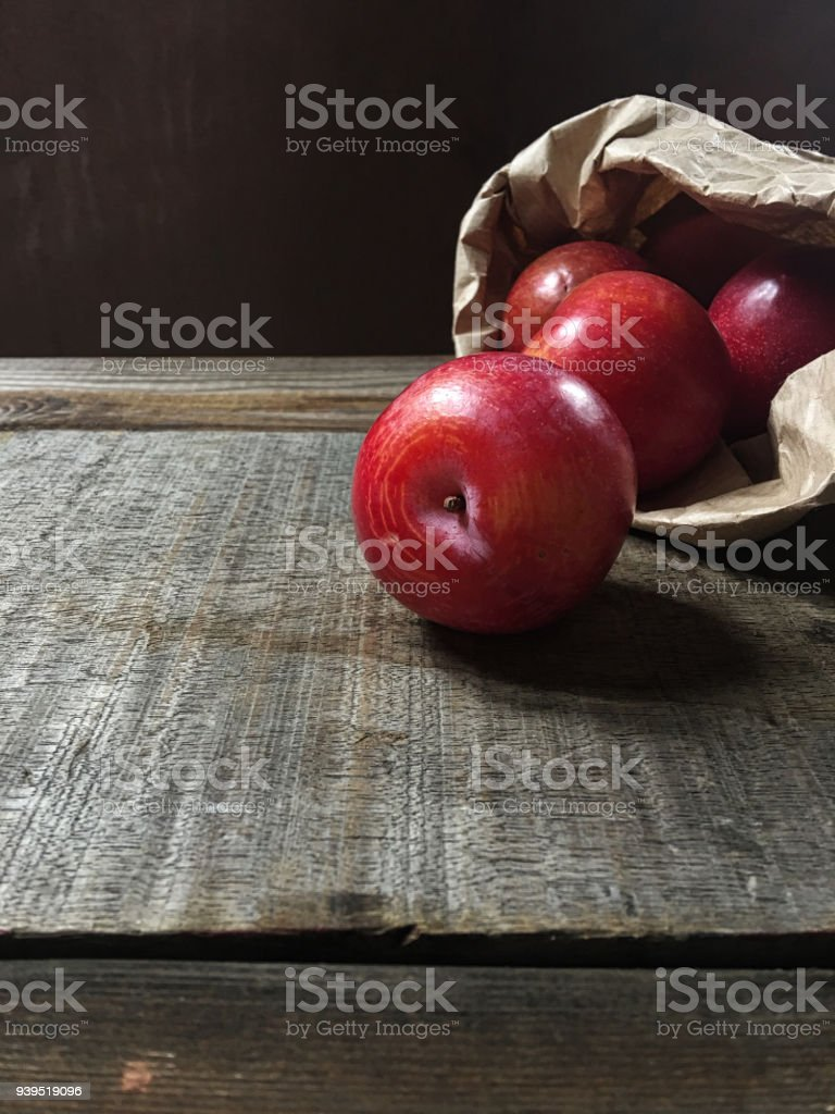 Plums On Wooden Table stock photo