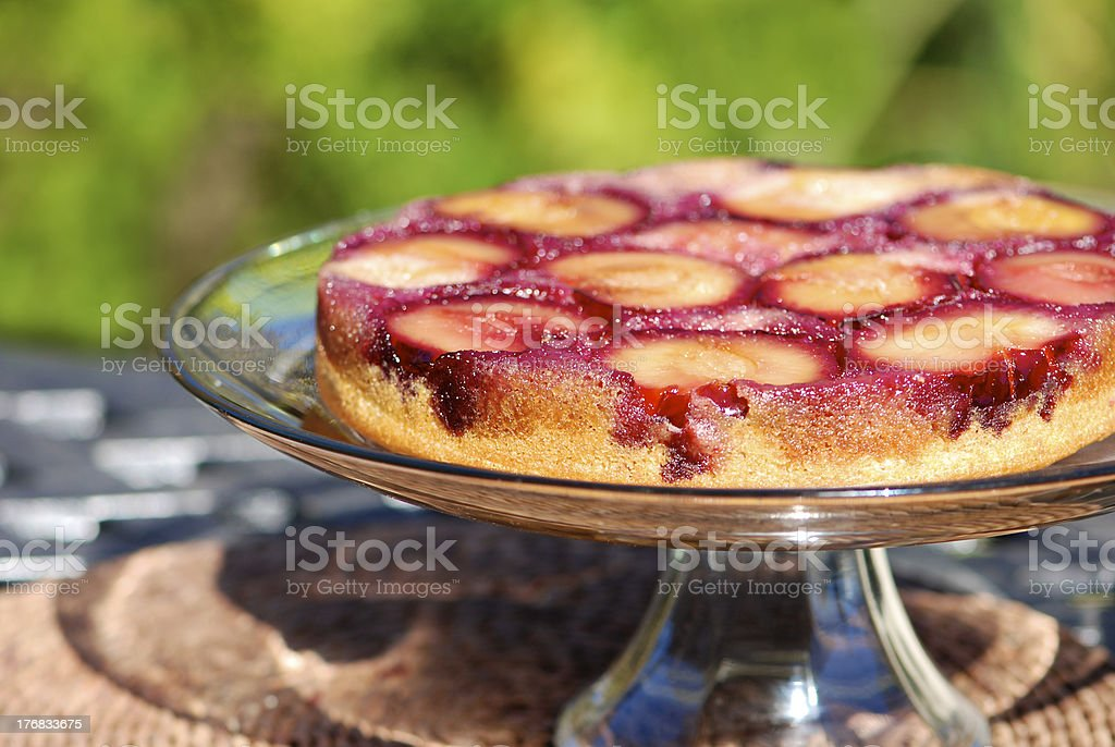 Plums upside down cake stock photo
