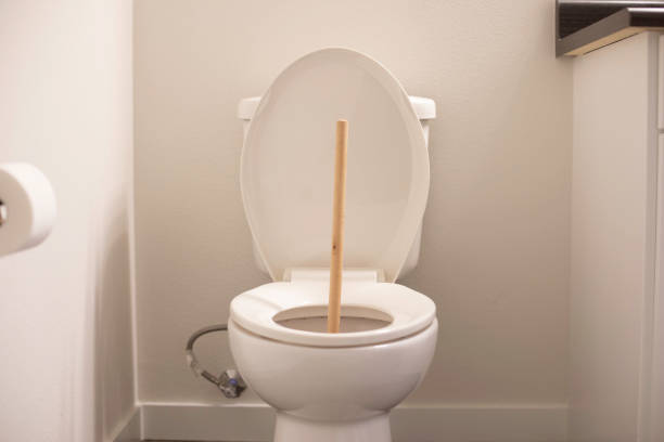 Plunger Toilet plunger in a bathroom , restroom, or washroom flushing toilet stock pictures, royalty-free photos & images