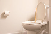 Toilet plunger in a bathroom , restroom, or washroom