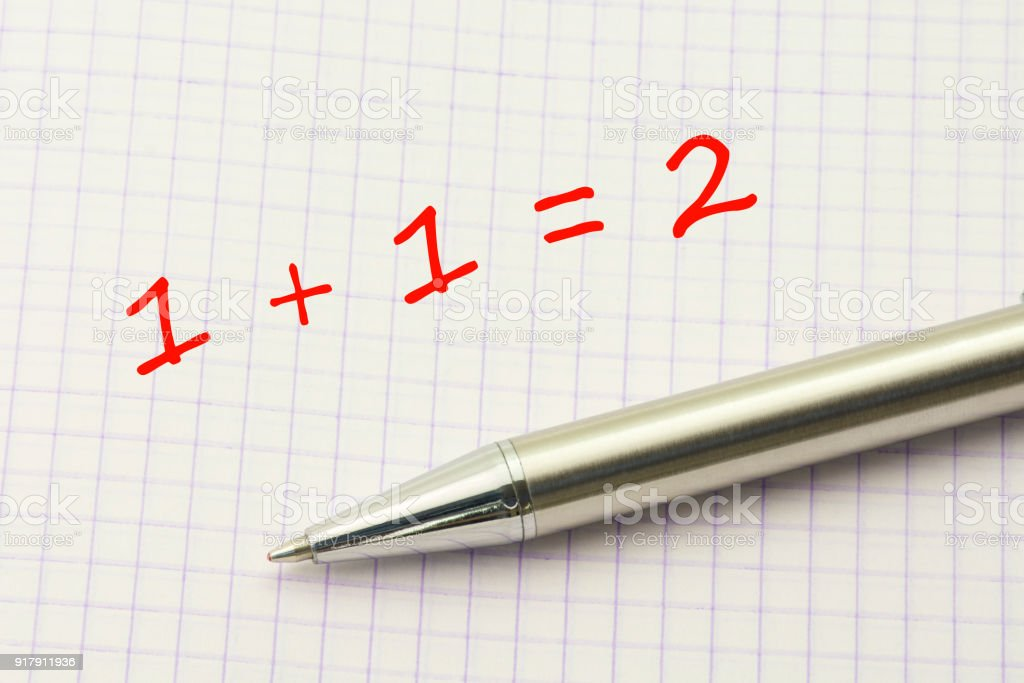 1 plus 1. Simple equation on a squared paper sheet. Math for children stock photo