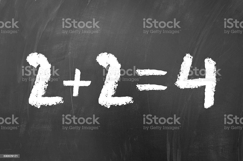2 plus 2 equals 4 stock photo