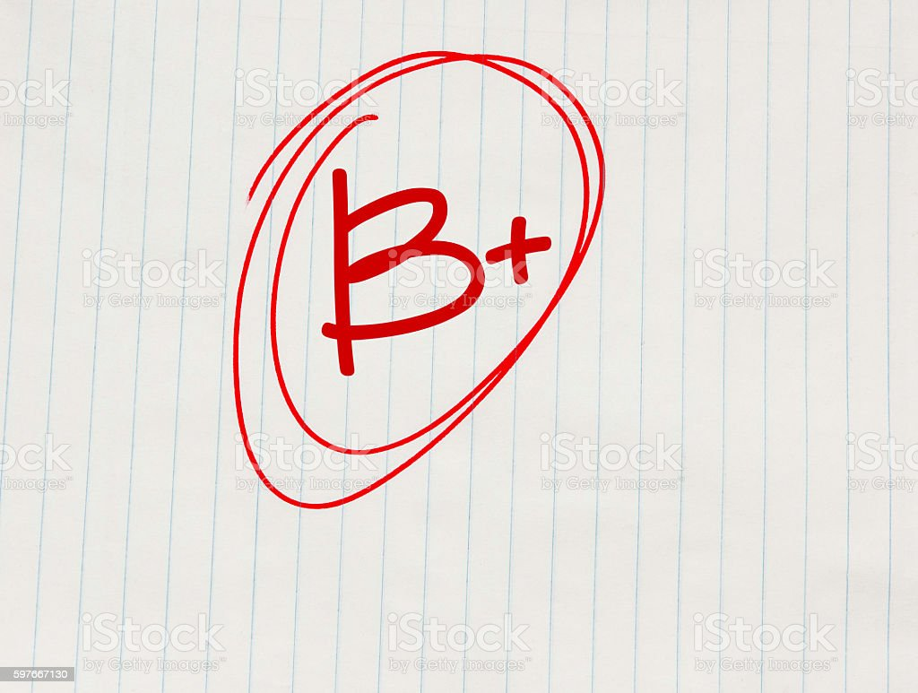 B plus (B+) grade written in red on notebook paper stok fotoğrafı