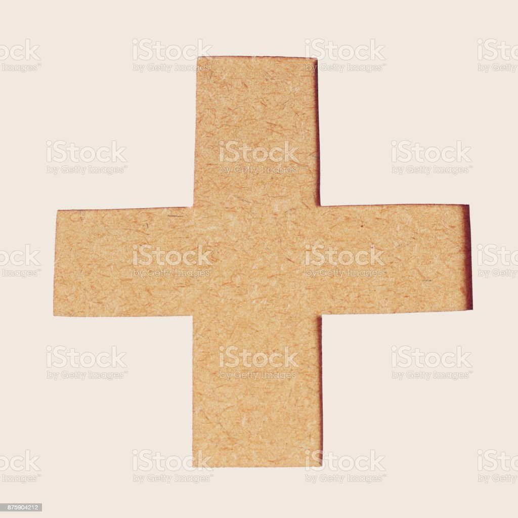 Plus sign. Positive symbol. Zoom in. of wood texture stock photo