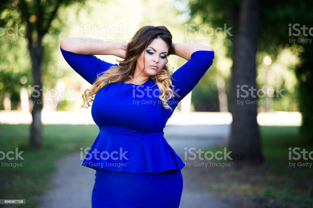 0eb2bcafa9ddb Plus Size Fashion Model In Blue Dress Outdoors Beauty Woman With ...