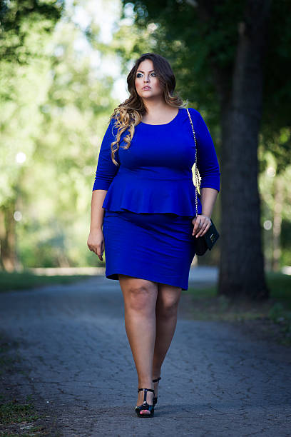 Plus size fashion model in blue dress outdoors, xxl woman - Photo