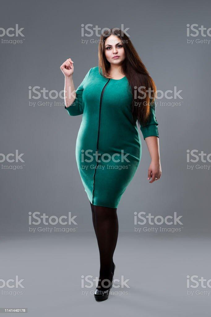 a028a9b075aba Plus Size Fashion Model In Green Dress Fat Woman On Gray Studio ...