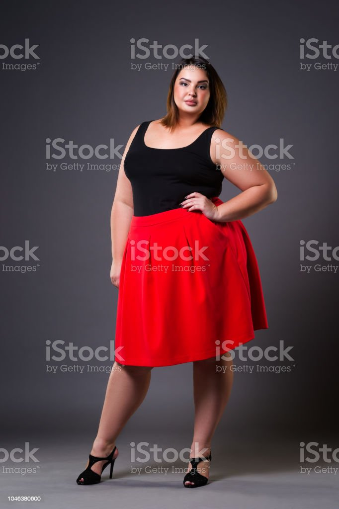 Plus Size Fashion Model In Red Skirt Fat Woman On Gray